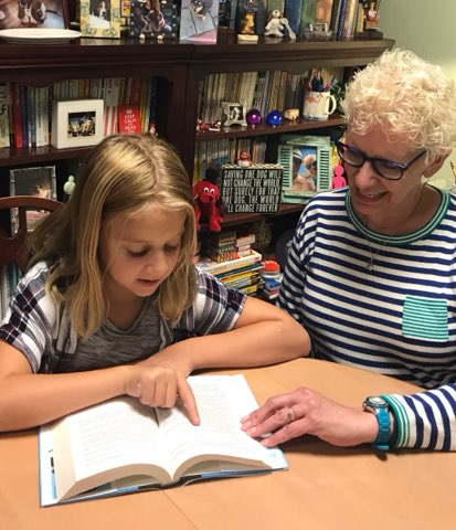 Student reading with organizational coach